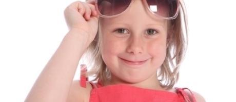 girl holding up sunglasses