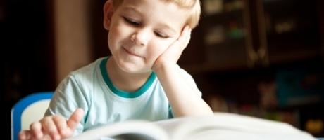 young boy reading a book