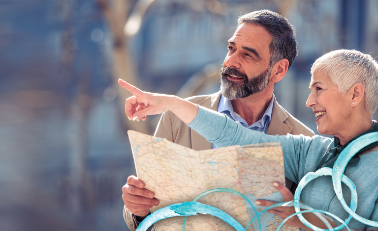 woman pointing directions to man with a map