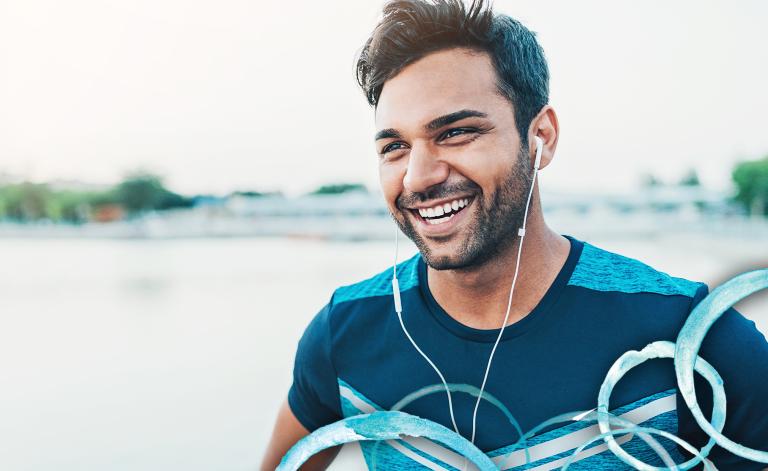 man smiling with earphones