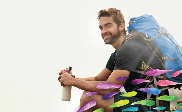 man hiking and holding a water bottle