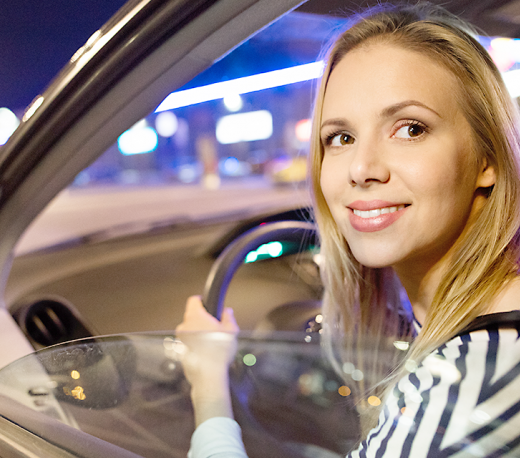 Woman driving with a blurry distance